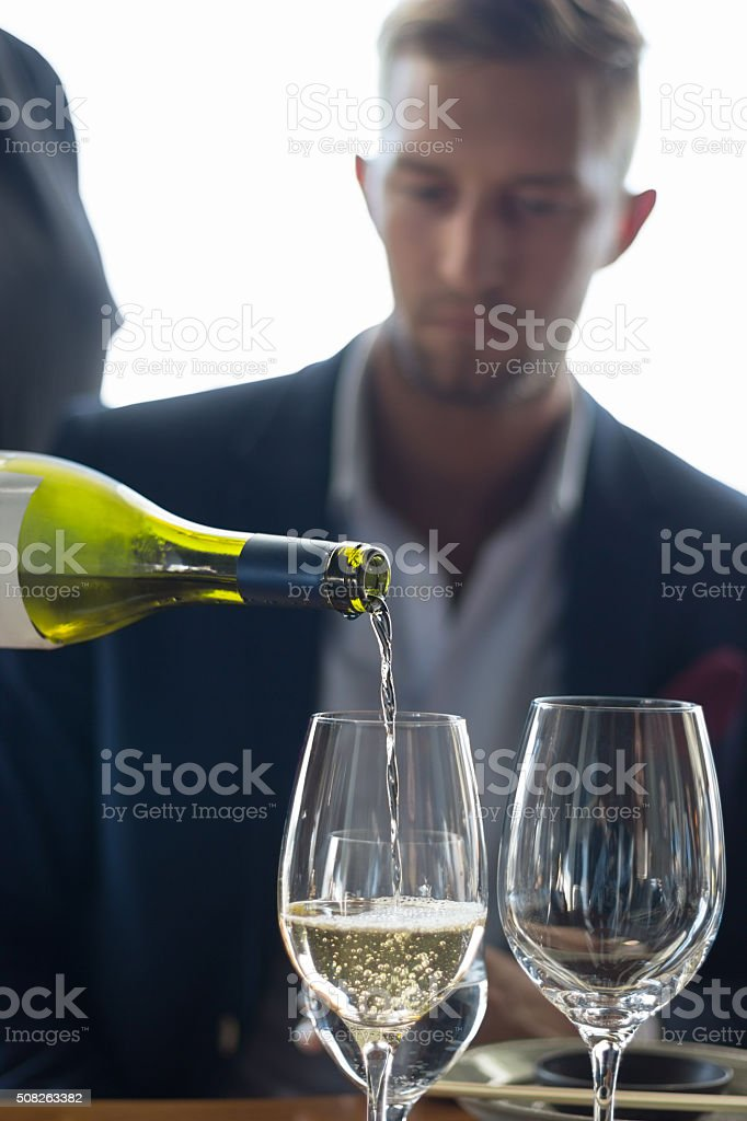 Serving white wine stock photo