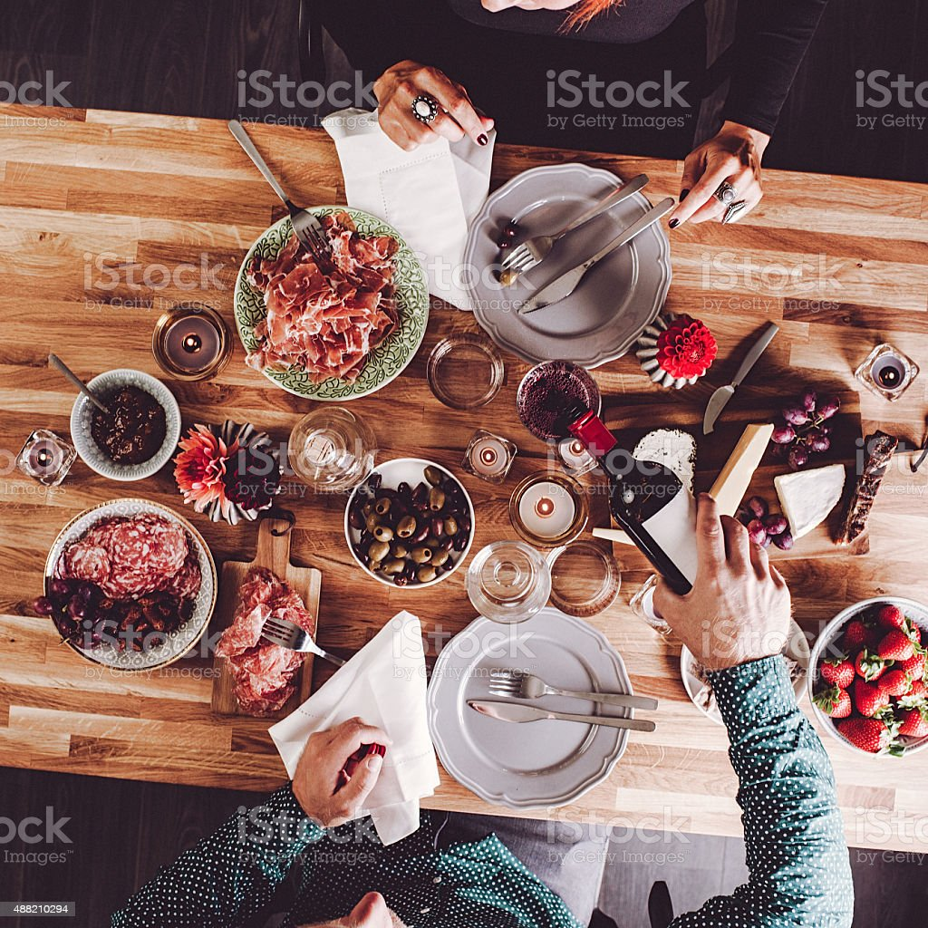 Serving wine with dinner stock photo