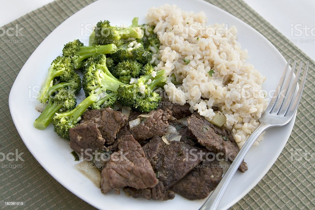 Sesame Beef with Rice and Broccoli royalty-free stock photo