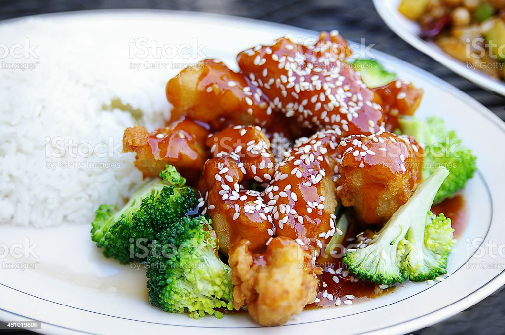 Sesame chicken with broccoli stock photo