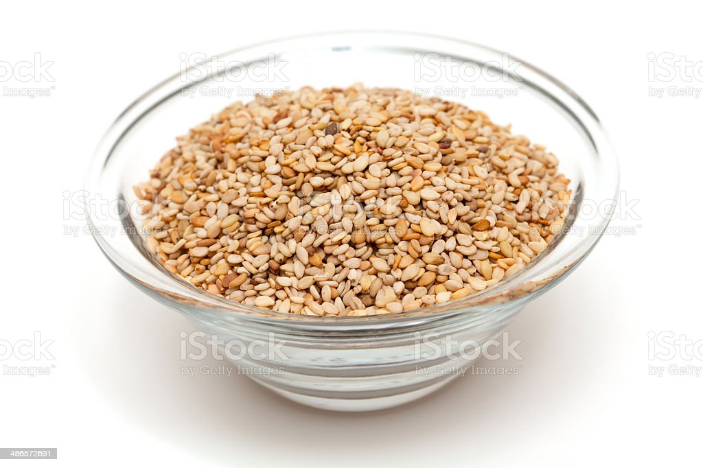 sesame in a glass bowl stock photo