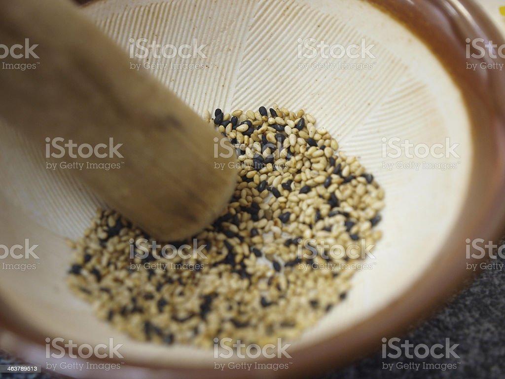 Sesame in mortar stock photo