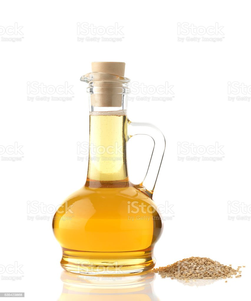 Sesame Oil on White Background stock photo