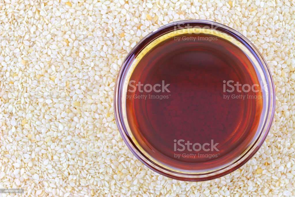 Sesame oil on white seeds stock photo