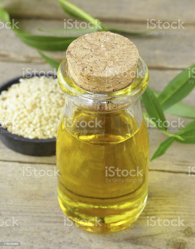 sesame seeds and oil on a wooden table royalty-free stock photo