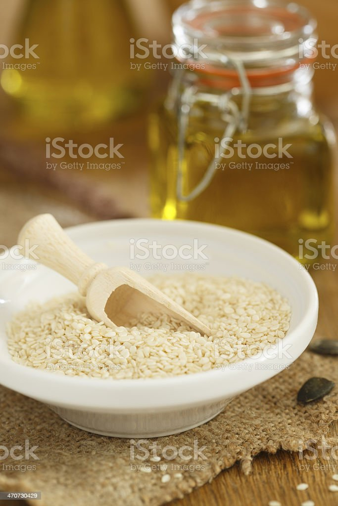 Sesame seeds and oil stock photo