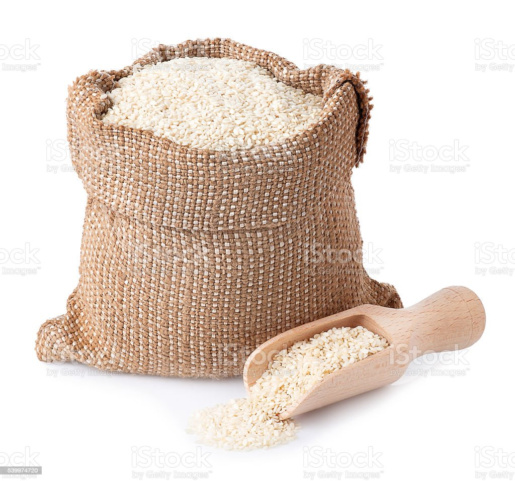 sesame seeds in bag with wooden scoop closeup stock photo