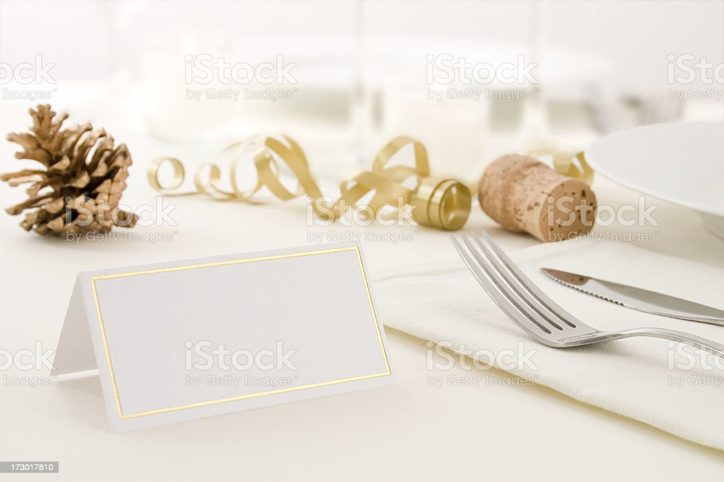 A set Christmas-decorated table with blank label stock photo