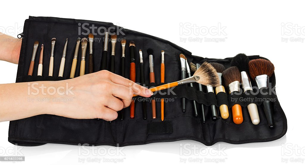 Set cosmetic brushes for makeup in hands women isolated. stock photo