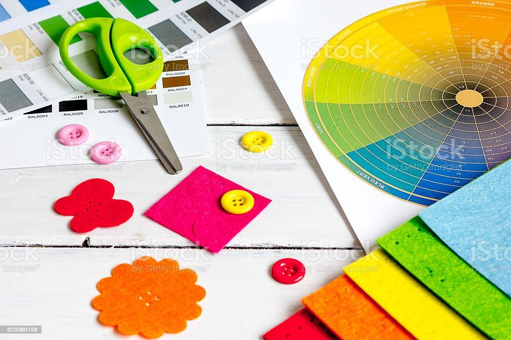 set designer palettes on working desk close up stock photo