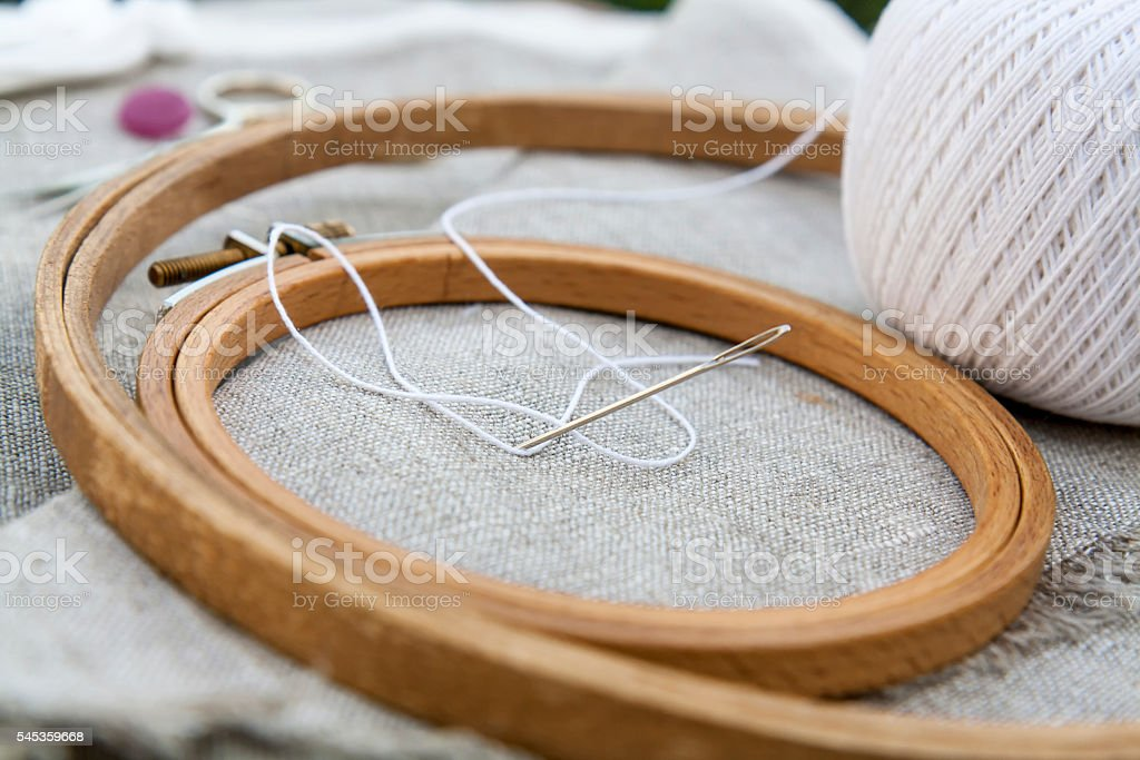 Set for embroidery, garment needle and embroidery hoop stock photo