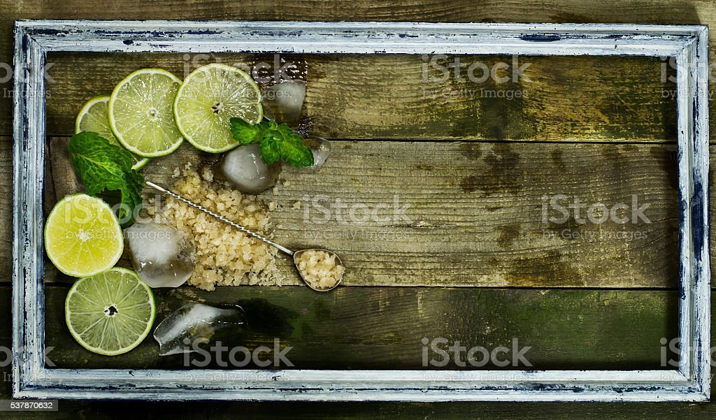 Set for Mojito - limes, mint and ice in frame stock photo