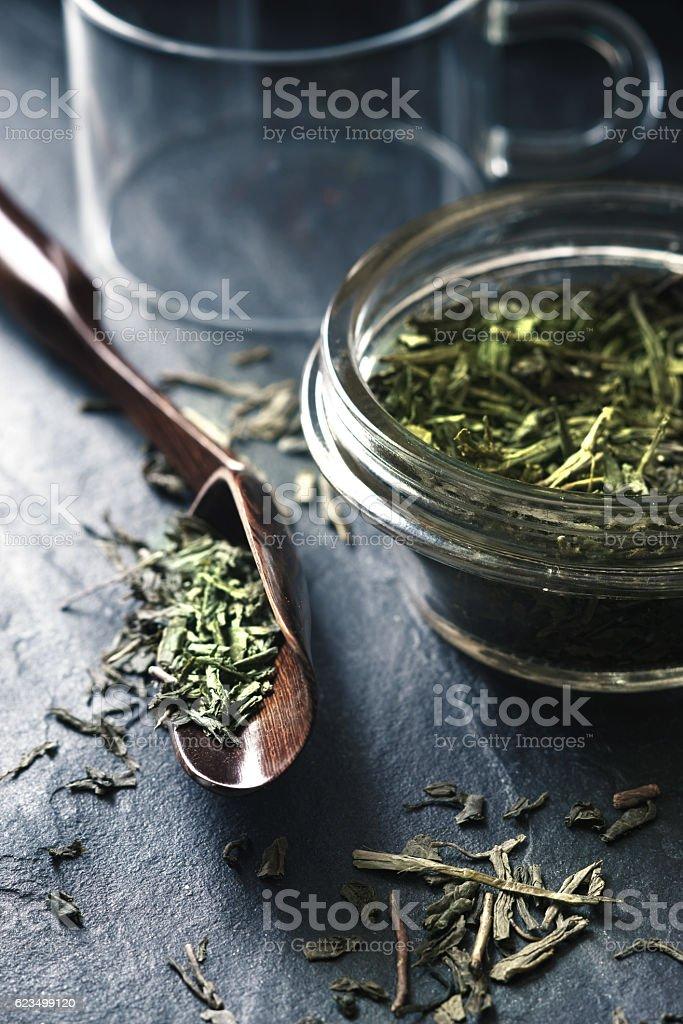 Set for tea preparation on  stone dark stone table vertical stock photo