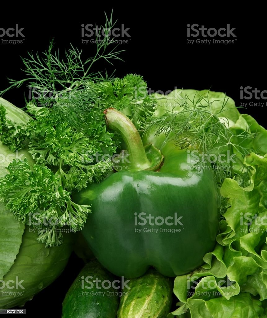 Set green vegetables-lettuce,bell pepper on black at the bottom stock photo