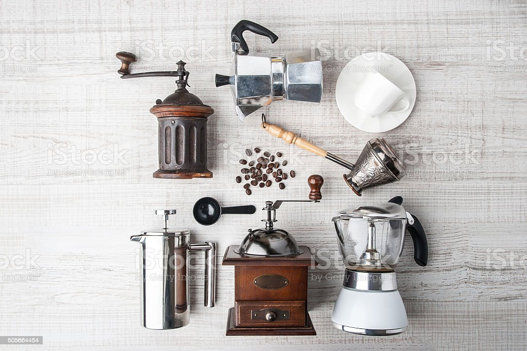 Set of accessories for coffee on the white wooden table stock photo