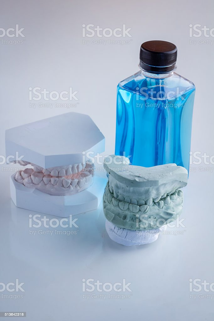 set of acrylic denture with mouth wash stock photo