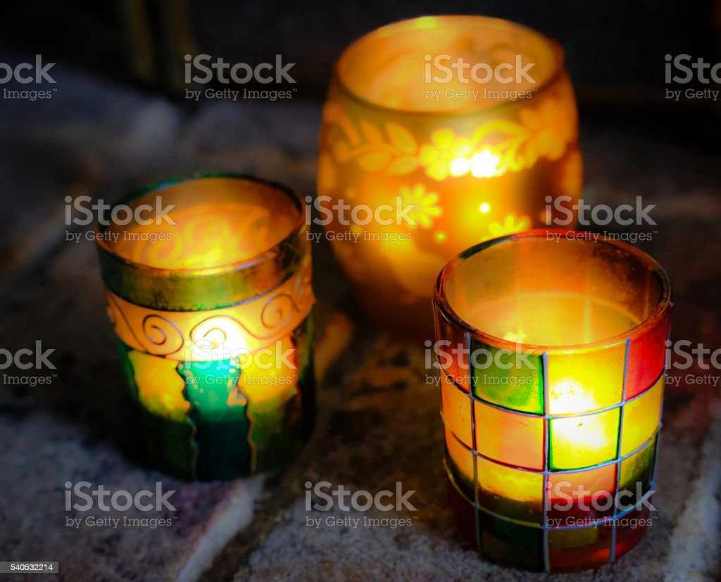 Set of african style glass lanterns in a fireplace stock photo