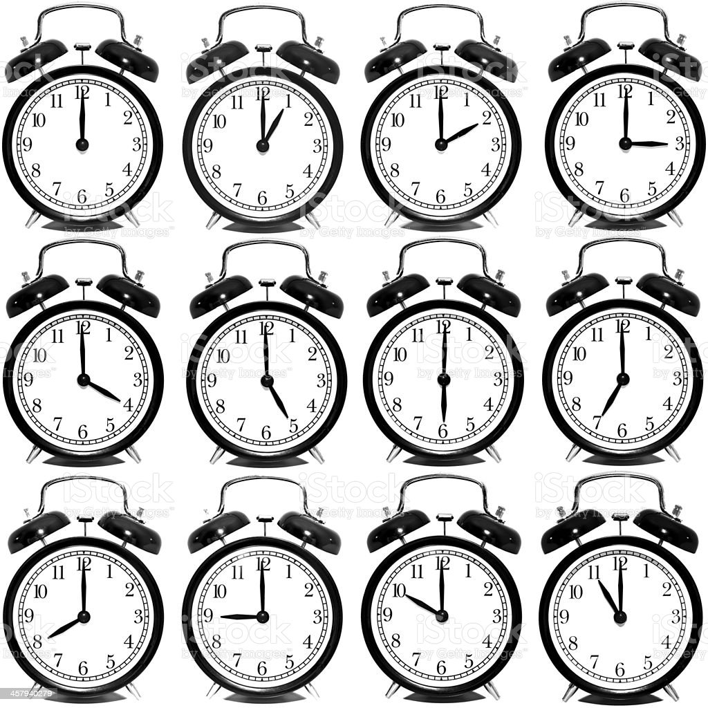 Set of alarm clocks showing every hour over white background stock photo