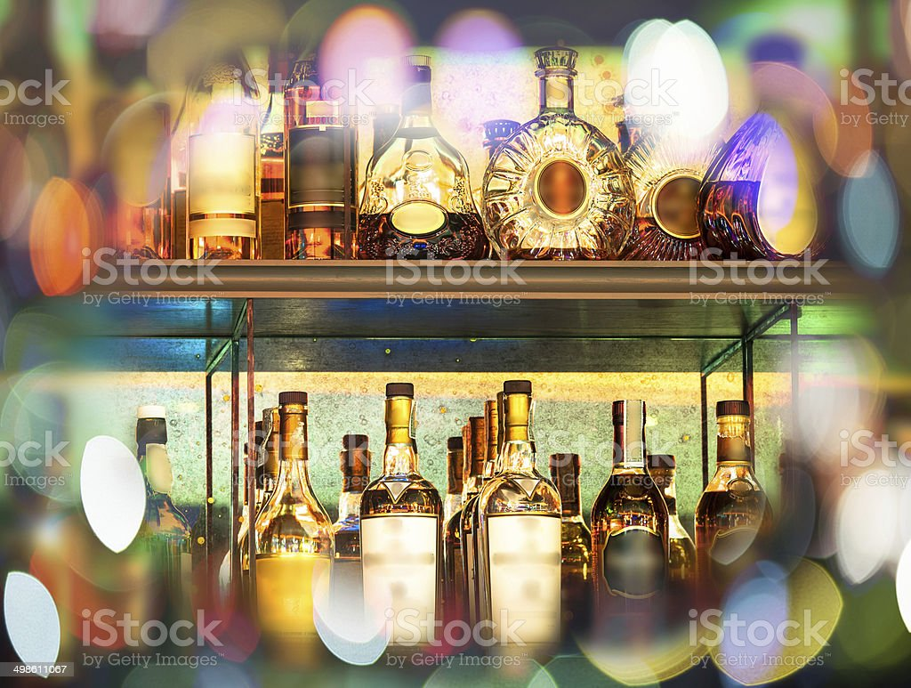 Set of Alcohol bottles on the wall with Bokeh stock photo