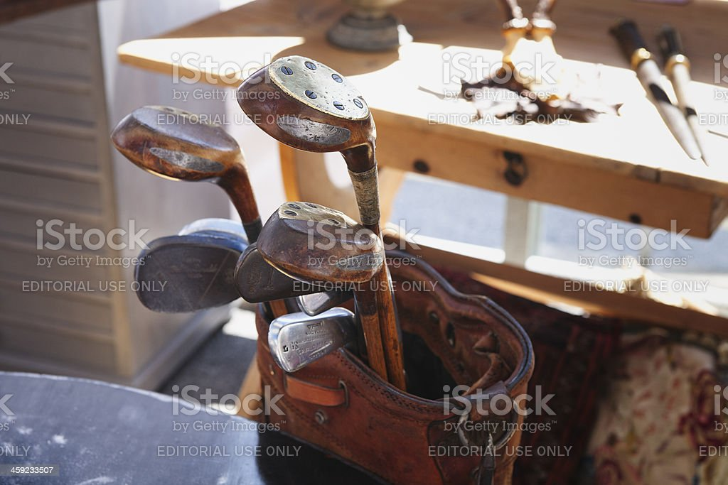 Set of antique, handmade golf clubs with wooden shafts stock photo