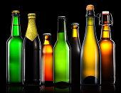 Set of beer bottles isolated on black background