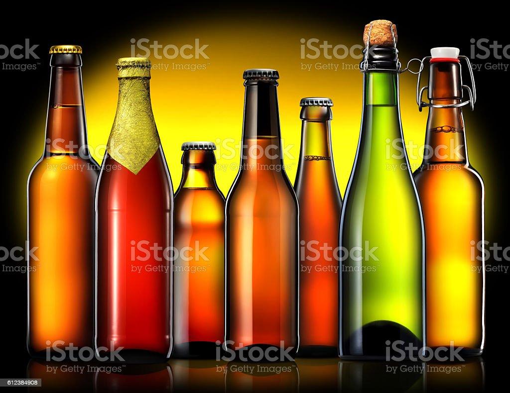 Set of beer bottles isolated on black background stock photo