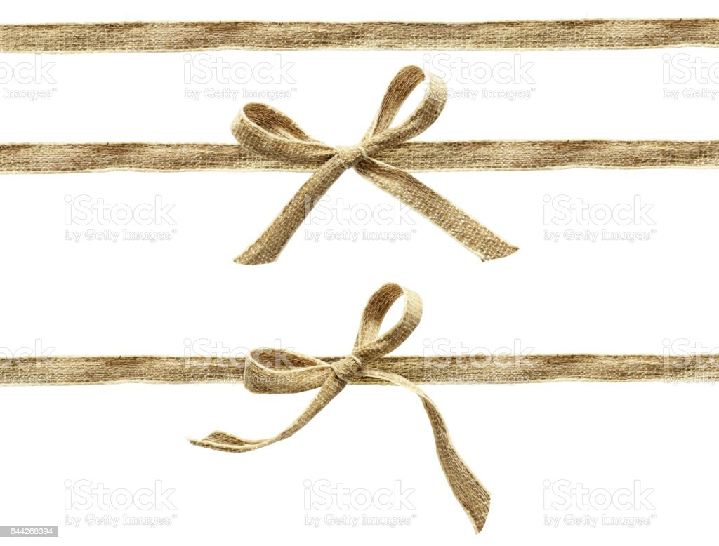 Set of beige canvas ribbons and a bows stock photo