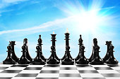 Set of black chess pieces on the chessboard
