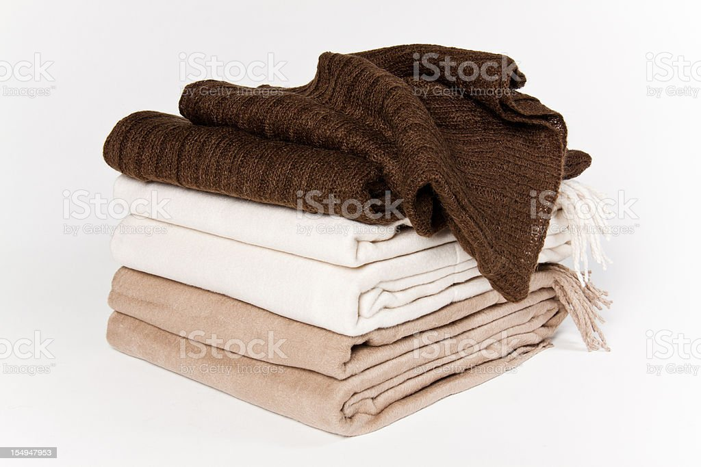 Set of blankets that are beige white and brown stock photo