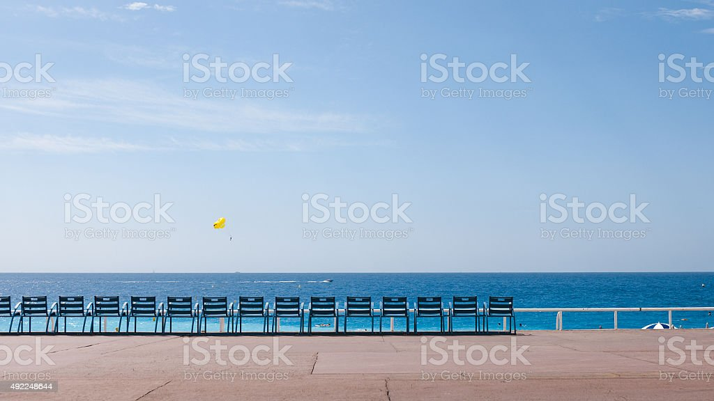 Set of blue chairs on the boulevard in Nice stock photo