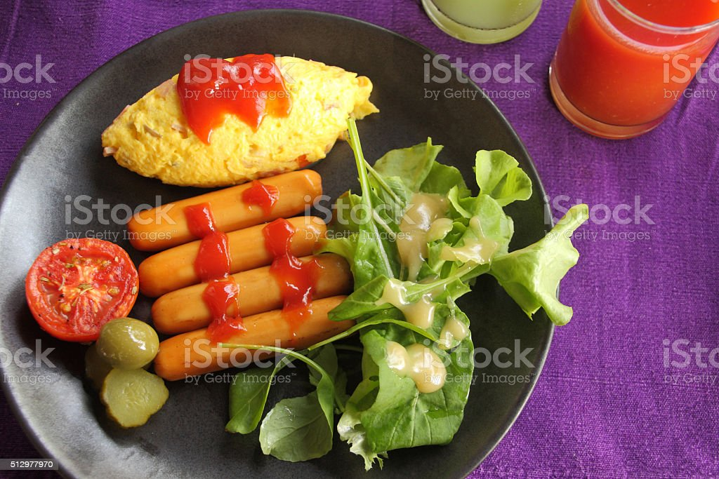 Set of breakfast, omelet, sausage and fresh vegetable salad. stock photo