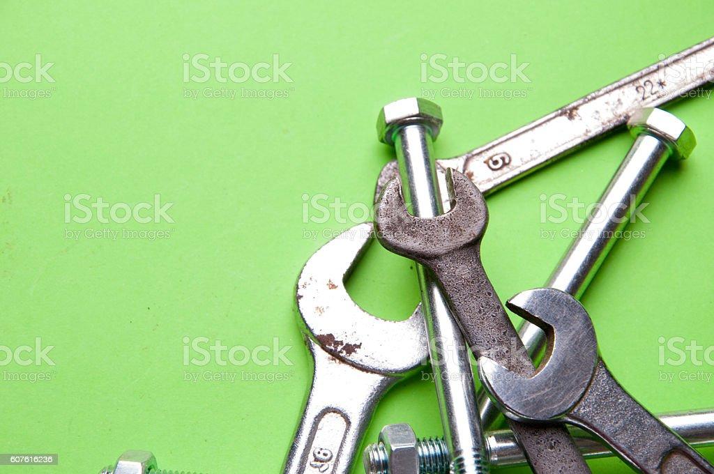 Set of brilliant nut keys on a green background stock photo
