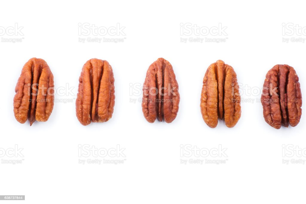 Set of Brown pecans piles isolated on a white background stock photo