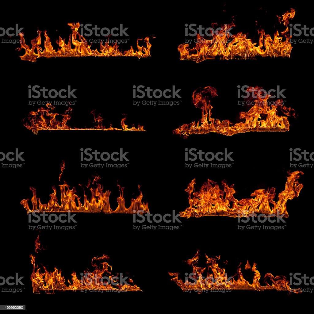 Set of burning fire flame elements isolated on black stock photo