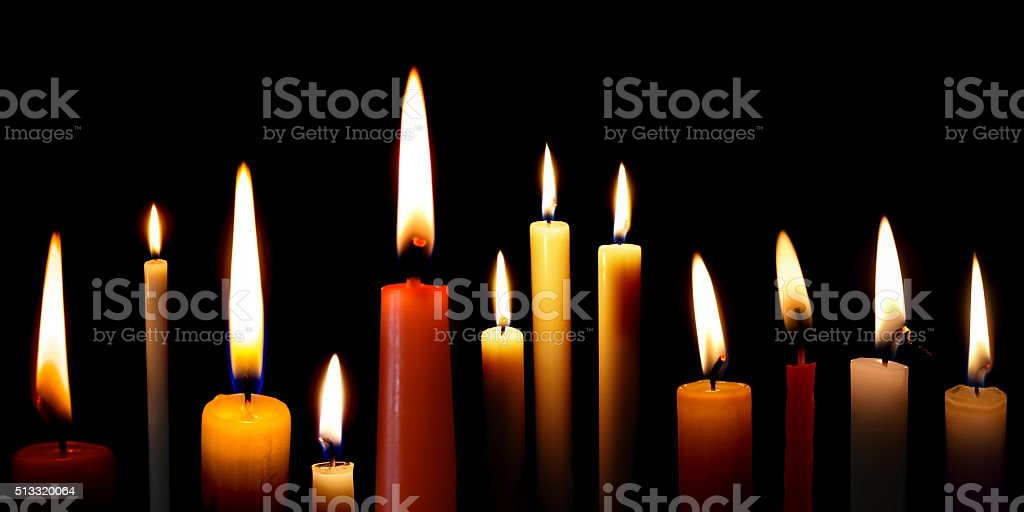 Set of candles in the dark stock photo