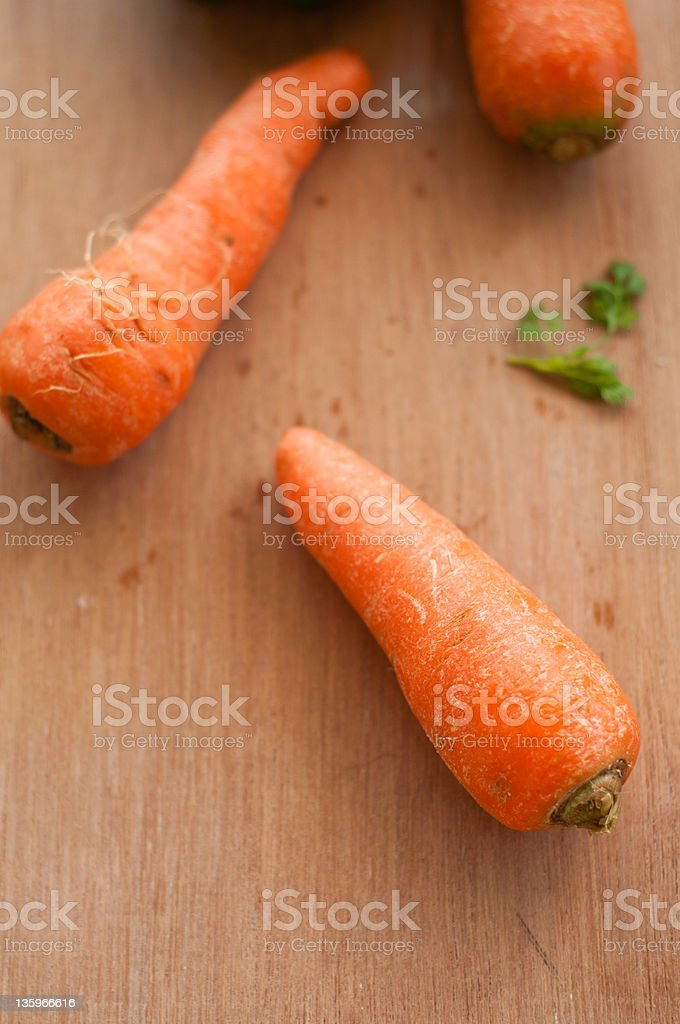 Set of carrots isolated on a wooden background royalty-free stock photo