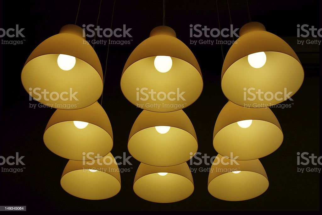 Set of ceiling lamps hanging on long cords royalty-free stock photo