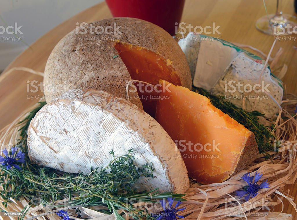 set of cheese on a straw stock photo