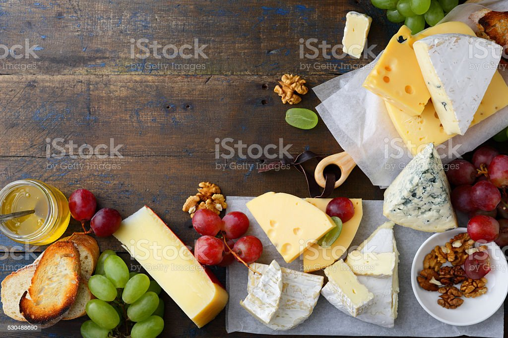 Set of cheeses with empty space background stock photo