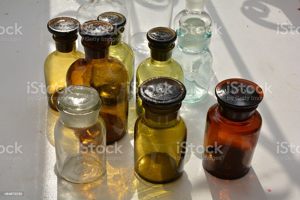 Set of chemical flasks of various colors stock photo
