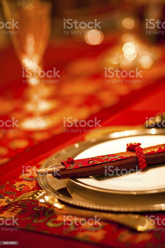 A set of Chinese chopsticks in a red sleeve stock photo