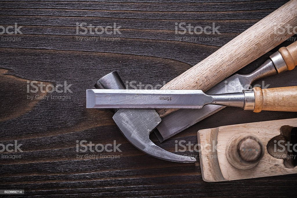 Set of claw hammer planer and firmer chisels on vintage stock photo