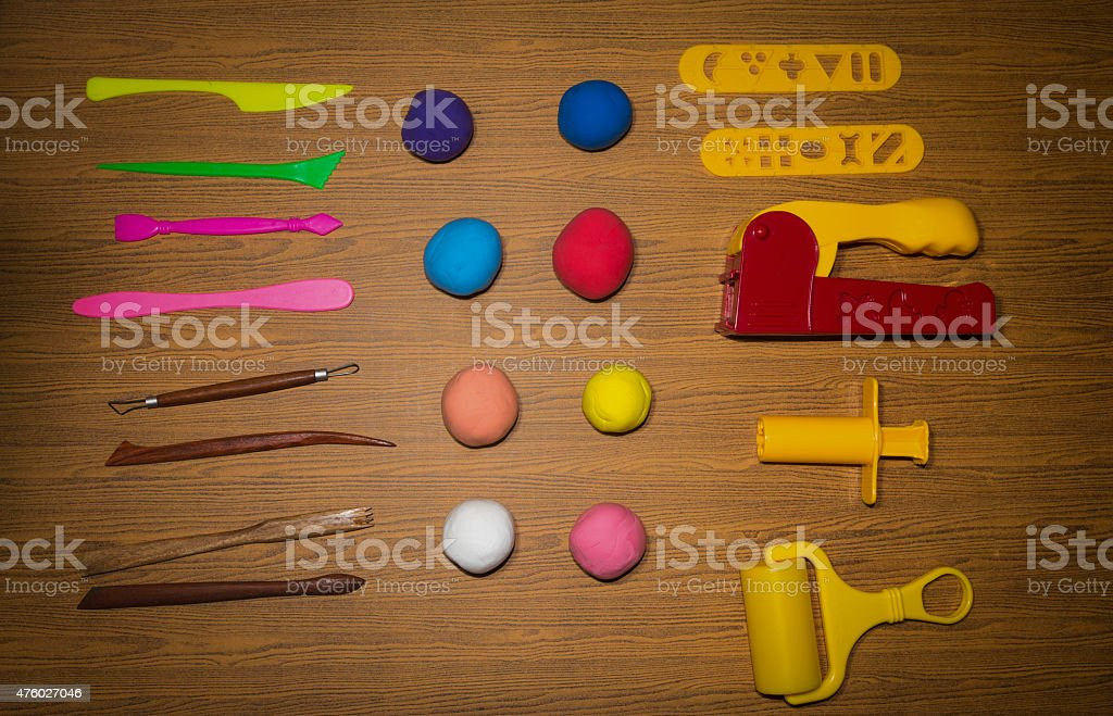 Set of clay equipment on wood background stock photo