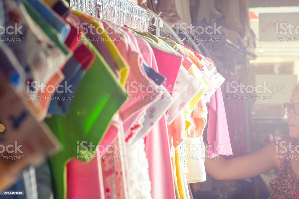 Set of clothes for kids on hangers. Shopping. stock photo