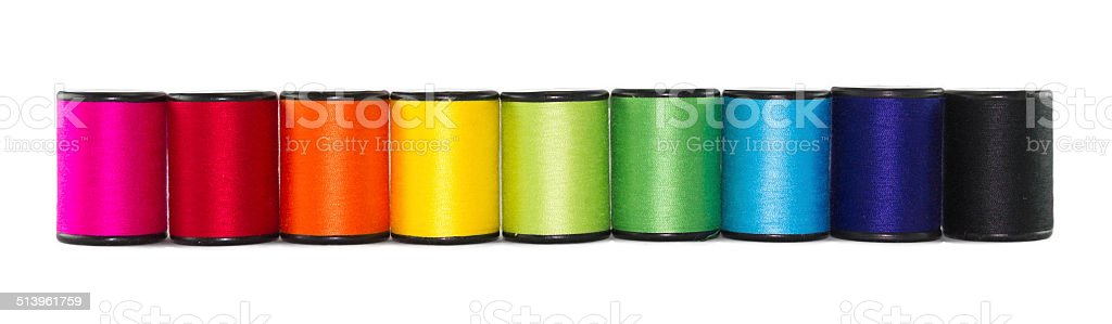 set of color threads on a white background stock photo
