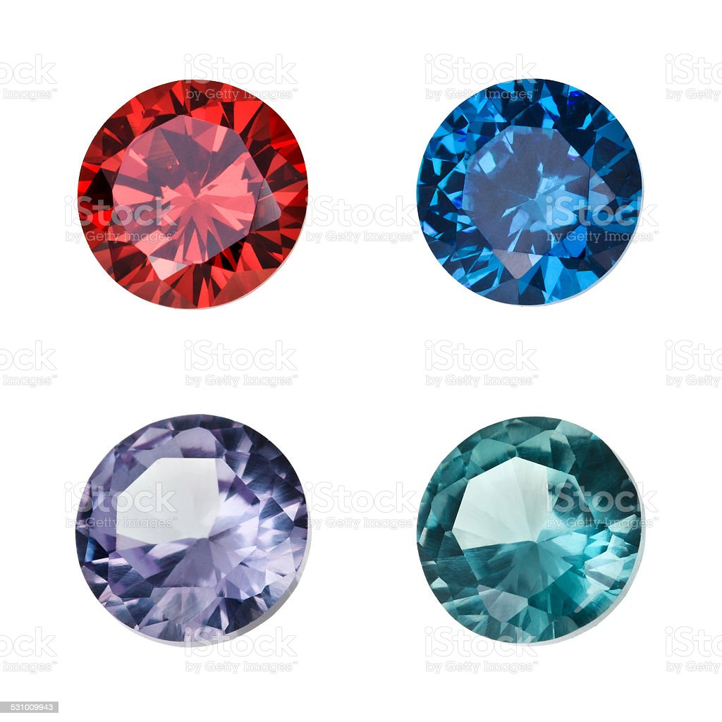 Set of colored gemstones isolated on white background stock photo