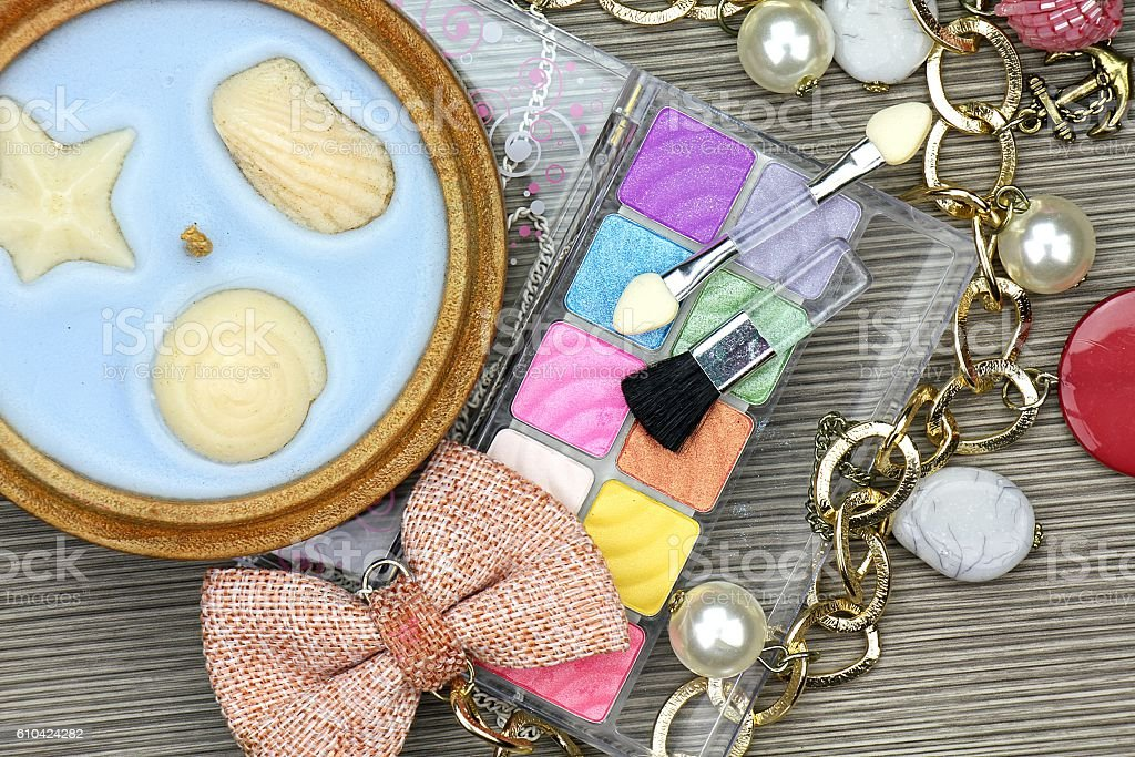 Set of colorful cosmetics and femenine accessories stock photo