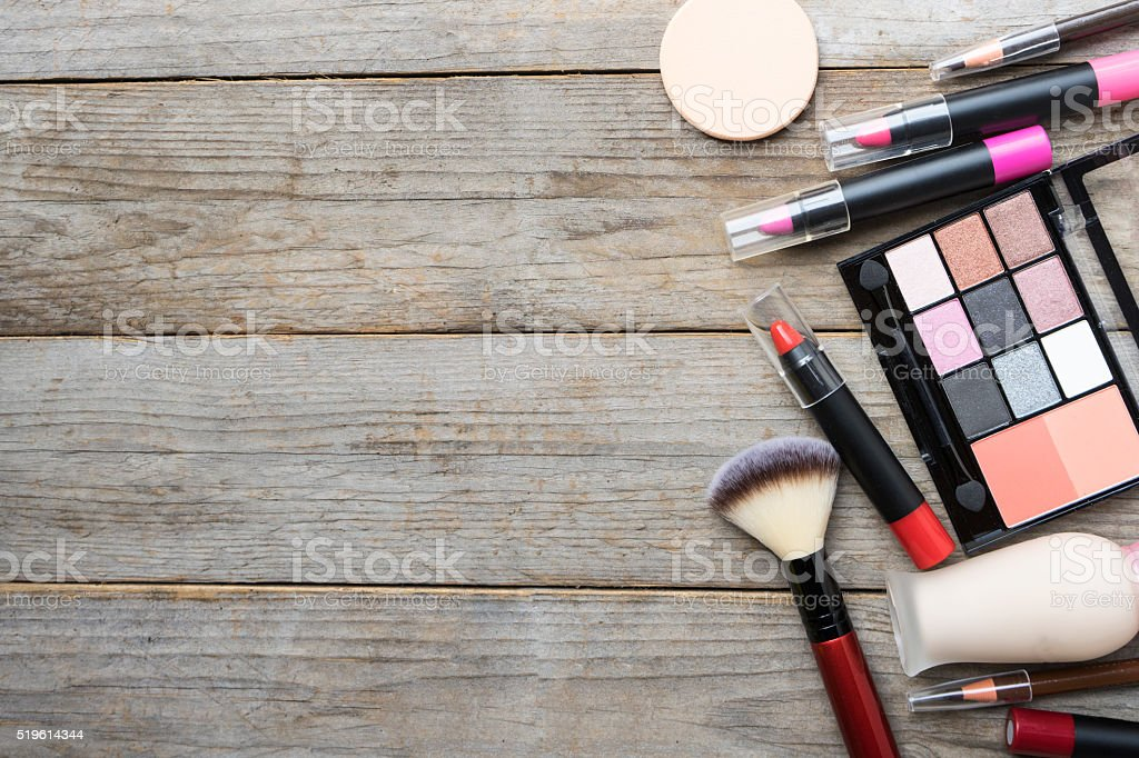 Set of colorful cosmetics on table background stock photo