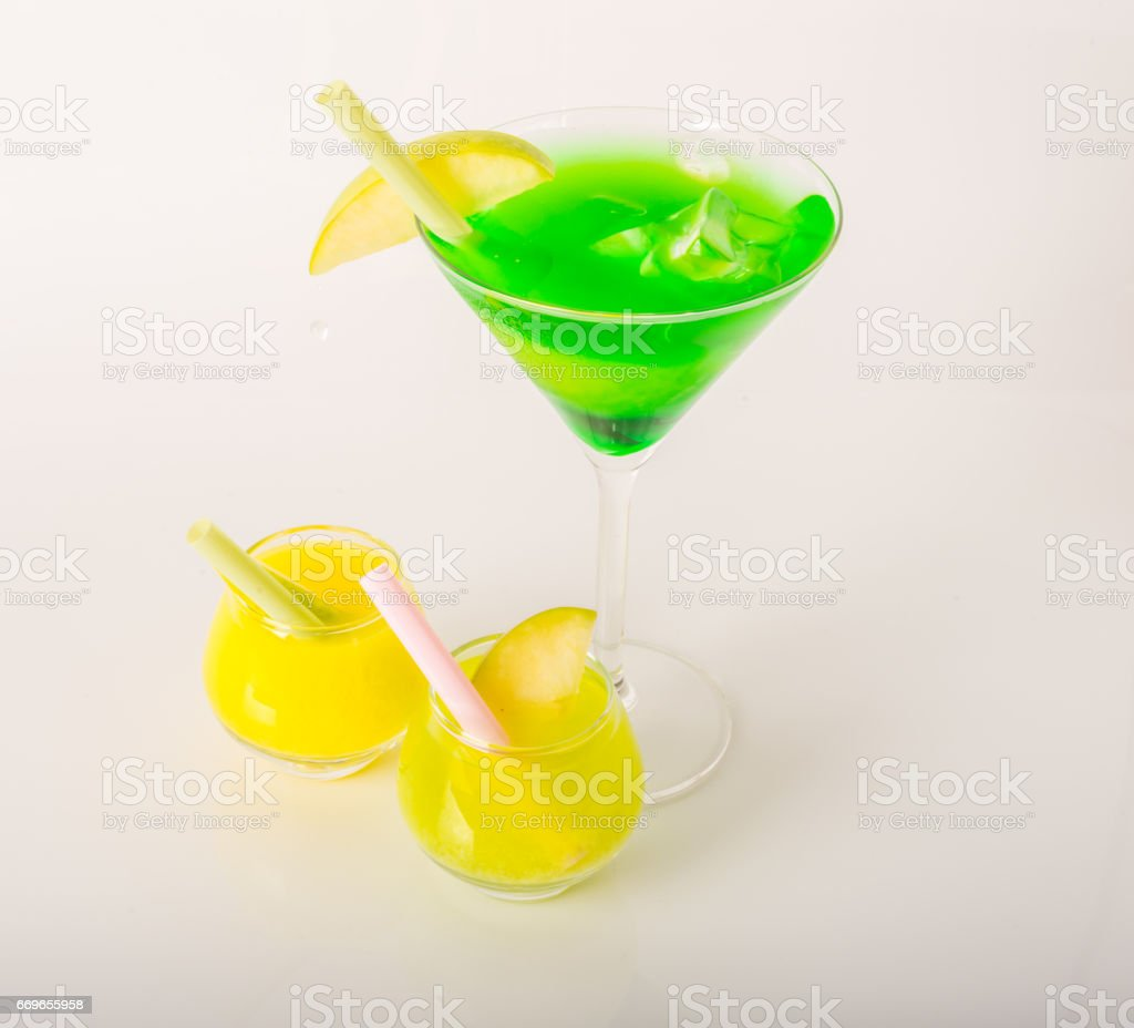 Set of colorful drinks, decorated with fruit, martini glass, shot glass stock photo