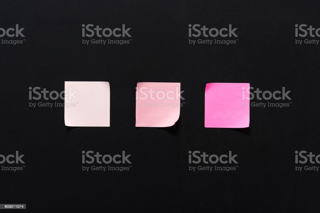 set of colorful empty notes with copy space on isolated on black stock photo